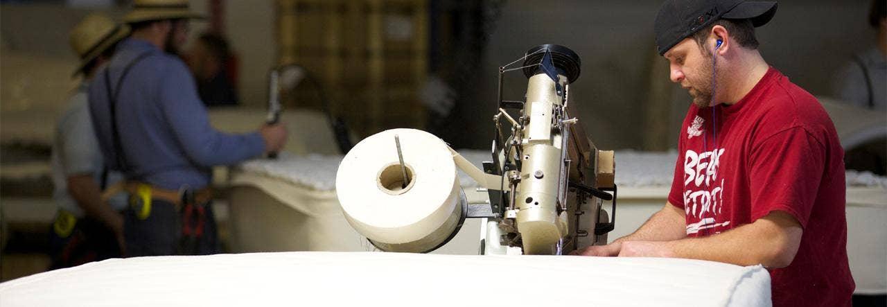 man making naturepedic mattress