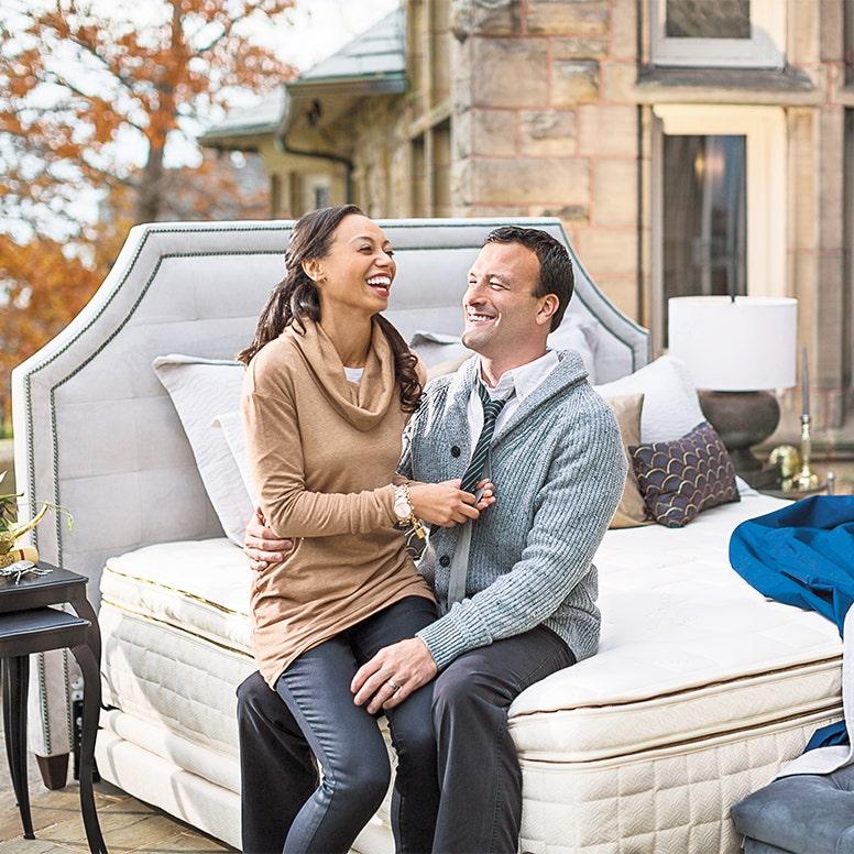 Couple laughin on mattress