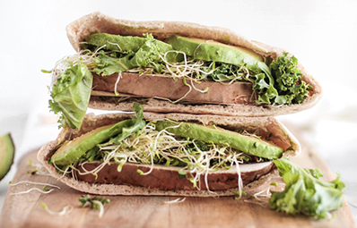 healthy sandwich with avocado and sprouts