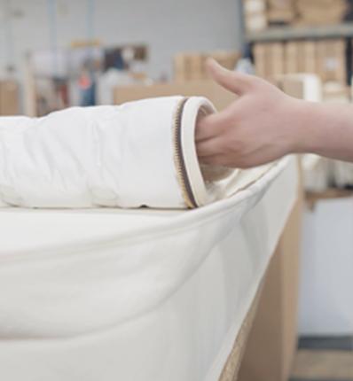 hand rolling back mattress quilt