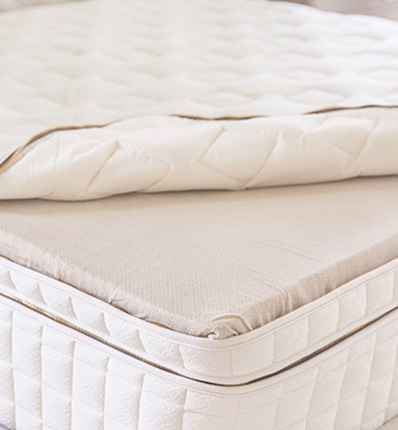 EOS Pillowtop mattress with quilt rolled back