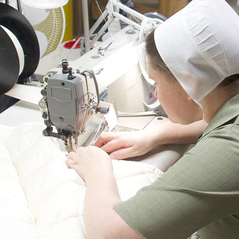 Close-up of Amish woman sewing