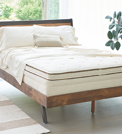 Angled shot of Arcadia mattress with sheets pulled back