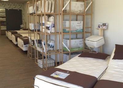 mattresses and accessory rack inside organic mattress gallery in Minneapolis Minnesota
