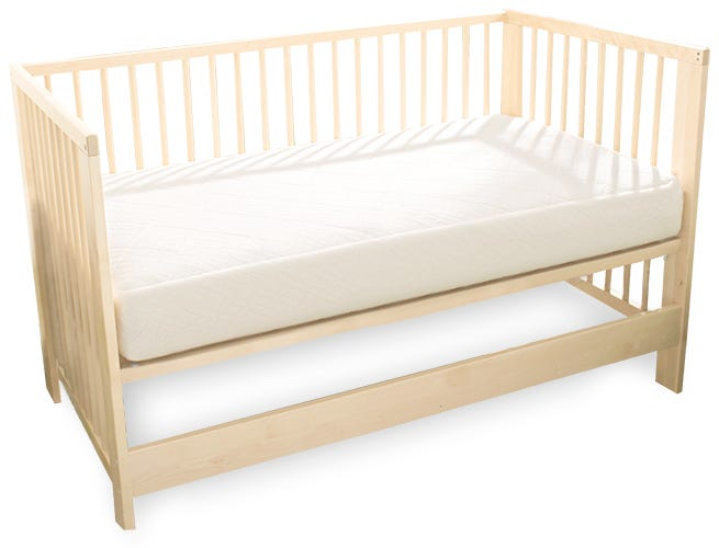 Breathable Ultra crib mattress in wooden crib